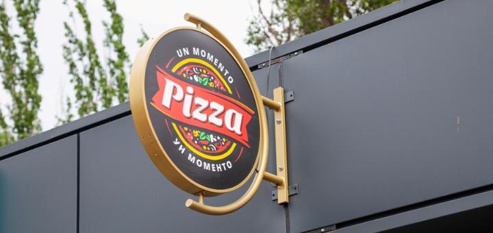 Скидка 50% на всё меню кухни в пиццерии «Un Momento»
